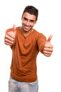 Smiling guy showing thumbs up over white background Stock Images