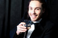 Smiling guy in tuxedo drinking cocktail handsome smart young wine at business party Royalty Free Stock Images
