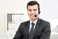 Smiling handsome businessman wearing microphone headset