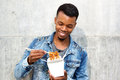 Smiling handsome man enjoying takeout noodles Royalty Free Stock Photo