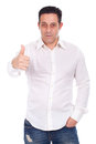 Smiling handsome man gesturing ok sign Stock Photos