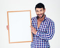 Smiling handsome man holding blank board portrait of a isolated on a white background Stock Photo