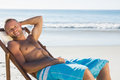 Smiling handsome man sunbathing on his deck chair Royalty Free Stock Photo