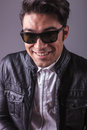 Smiling handsome man wearing black sunglasses. Royalty Free Stock Photo
