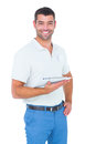 Smiling handyman with clipboard on white background Royalty Free Stock Photo