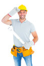 Smiling handyman holding spirit level Royalty Free Stock Photo