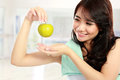 Smiling happy asian woman fitness model portrait of confident in sportswear and hold green apple Stock Photos