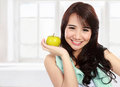 Smiling happy asian woman fitness model portrait of confident in sportswear and hold green apple Royalty Free Stock Photography