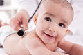 Smiling happy baby with doctor pediatrician Royalty Free Stock Photo