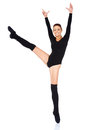 Smiling happy ballet dancer beautiful working out in a black leotard holding a graceful en pointe pose on one foot with her arms Royalty Free Stock Photo