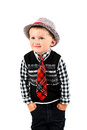 Smiling happy boy in hat and tie shot in the studio on a white b Royalty Free Stock Photo