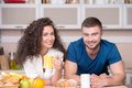 Smiling happy couple drinking morning coffee in portrait of a the kitchen Royalty Free Stock Image