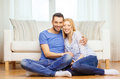 Smiling happy couple at home love family and happiness concept sitting on floor Royalty Free Stock Photography