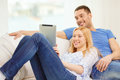 Smiling happy couple with tablet pc at home love family technology internet and happiness concept witl computer Stock Image