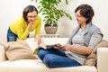 Smiling happy women couple family reading magazine Royalty Free Stock Photo