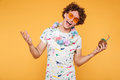 Smiling happy young man in sunglasses and beach wear Royalty Free Stock Photo
