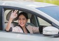 Smiling happy young woman in the car Royalty Free Stock Photo