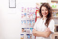 Smiling healthcare system worker in pharmacy Royalty Free Stock Photo