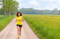 Smiling healthy young woman jogging in nature Royalty Free Stock Photo