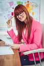 Smiling hipster businesswoman at her desk Royalty Free Stock Photo