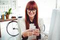 Smiling hipster businesswoman texting on her smartphone Royalty Free Stock Photo