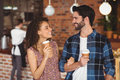 Smiling hipster couple with take-away cups Royalty Free Stock Photo