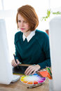 smiling hipster designer writing on a digital tablet Royalty Free Stock Photo