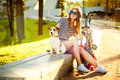 Smiling Hipster Girl with her Dog and Bike Royalty Free Stock Photo