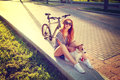 Smiling Hipster Girl with Pet and Bike in Summer Royalty Free Stock Photo