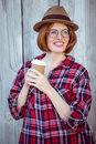 smiling hipster woman holding a coffee cup Royalty Free Stock Photo