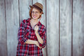 smiling hipster woman holding a pencil Royalty Free Stock Photo