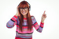 Smiling hipster woman listening music with headphones against white background Royalty Free Stock Photo