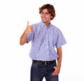 Smiling hispanic man making at you ok sign portrait of a on isolated background Royalty Free Stock Photos