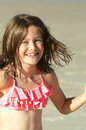 Smiling holiday girl portrait of pretty pre teen on holidays at the beach and being happy Stock Photo