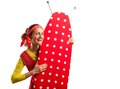 Smiling housewife with ironing board happy Royalty Free Stock Image