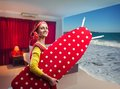 Smiling housewife with ironing board happy going to the sea Stock Photo