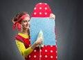 Smiling housewife with ironing-board Royalty Free Stock Photo