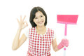 Smiling housewife woman with a cleaning on white background Royalty Free Stock Images