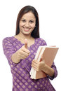 Smiling Indian female student against white Royalty Free Stock Photo