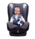 Smiling infant baby boy sitting in a car seat, isolated on white Royalty Free Stock Photo