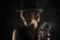 Smiling jazz singer with retro microphone closeup Royalty Free Stock Photo