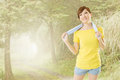 Smiling jogging woman take a rest after training closeup portrait at mist forest Royalty Free Stock Photo