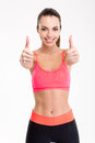 Smiling joyful fitness girl showing thumbs up with both hands Royalty Free Stock Photo