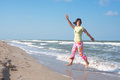 Smiling joyful woman is jumping in surf Royalty Free Stock Photo