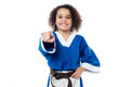 Smiling karate girl pointing towards you Royalty Free Stock Photo