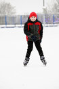 Smiling kid on the ice rink standing outdoors Stock Photo