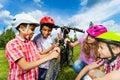 Smiling kids in helmets repair bike together Royalty Free Stock Photo