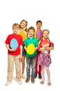 Smiling kids holding egg shape colourful cards Royalty Free Stock Photo