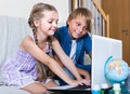Smiling kids ordinary surfing internet Royalty Free Stock Photo