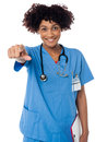 Smiling lady doctor pointing you out Royalty Free Stock Photo